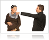 Man Pointing to Woman